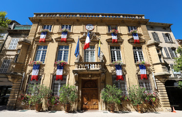 The town hall of Salon-en-Provence decorated with national flags , South of France .