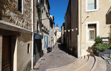 The typical alley in an old town in the South of France.