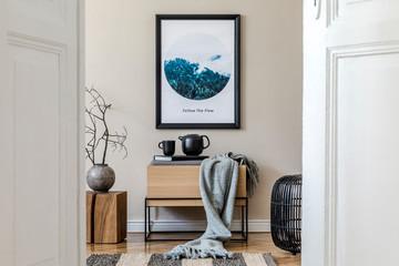 Modern scandinavian living room interior with mock up poster frame, design commode, flower in vase, black rattan basket, books , tea pot and elegant accessories. Template Stylish home staging. Japandi