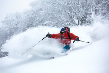 A skier is in the deep snow.