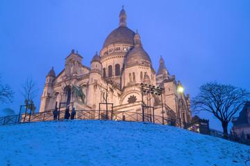The basilica Sacre Coeur in winter Paris, France.