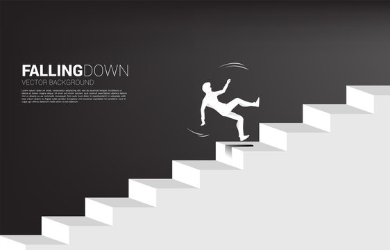 silhouette of businessman slip on stair. Concept for fail and accidental business