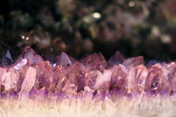 Pink crystal gem stone amethyst in nature. Gemstone amethyst, deposit, macro