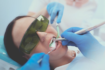 Dental team and patient at dentist's surgery