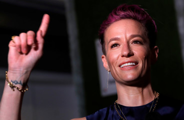 Megan Rapinoe poses as she arrives for Sports Illustrated Sportsperson of the Year Awards in New York