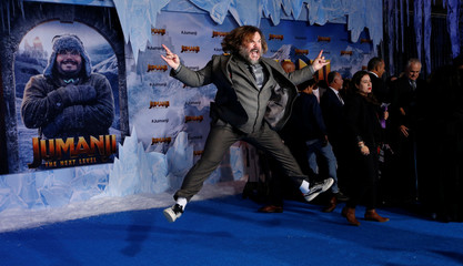 "Cast member Black jumps at the premiere for the film ""Jumanji: The Next Level"" in Los Angeles"