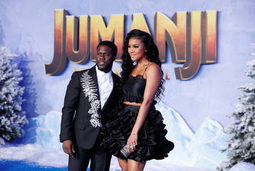 "Cast members Hart and his wife Parrish pose at the premiere for the film ""Jumanji: The Next Level"" in Los Angeles"