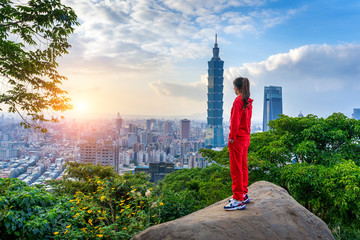 Wall Mural - Tourist woman enjoying view on mountains in Taipei, Taiwan.