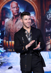 "Cast member Jonas poses at the premiere for the film ""Jumanji: The Next Level"" in Los Angeles"