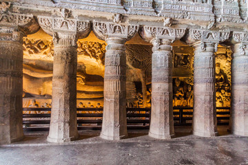Columns in the chaitya (prayer hall), cave 26, carved into a cliff in Ajanta, Maharasthra state, India