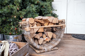 Firewood basket full of dry wood during wintertime.