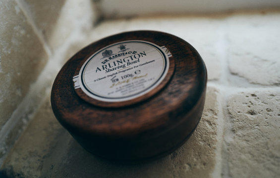 NEWCASTLE UPON TYNE, ENGLAND, UK - AUGUST 02, 2019: A closeup of a wooden bowl of traditional shaving soap from Dr Harris.