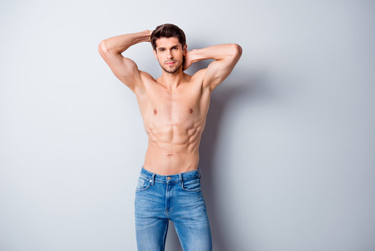 Photo of handsome macho man guy holding hands touch perfect hairdo topless sporty torso metrosexual hot tender body wear jeans isolated grey background