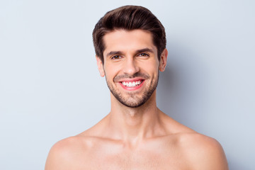 Obraz Close-up portrait of his he nice attractive bearded cheerful cheery glad brown-haired guy perfect smooth soft silky flawless skin beaming smile isolated on light white grey color pastel background - fototapety do salonu