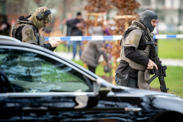 Police officers are seen near the site of a shooting in Ostrava