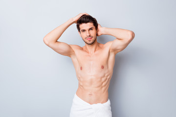 Portrait of masculine brutal macho man have hairstylist hygiene procedure touch clean haircut enjoy anti dander shampoo white towel isolated grey color background