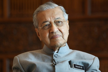 Malaysia's Prime Minister Mahathir Mohamad looks on during an interview with Reuters in Putrajaya
