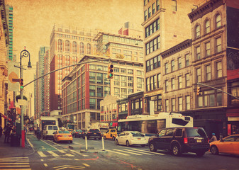 City Life and traffic on Manhattan avenue ( Ladies' Mile Historic District) at daylight , New York City, United States. Photo in retro style. Added paper texture. Toned image