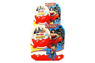 Italy – March 23, 2019: Kinder JOY Merendero JUSTICE LEAGUE Chocolate Eggs. Kinder  is a brand of products made in Italy by Ferrero, Justice League is a Trademark of DC Comics WB SHIELD WBEI