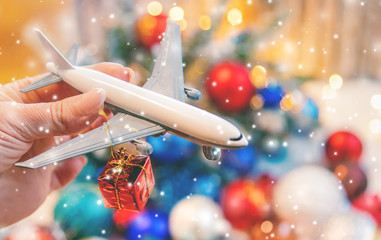 Wall Mural - Beautiful christmas background with airplane. Travel concept for christmas and new year. Selective focus.