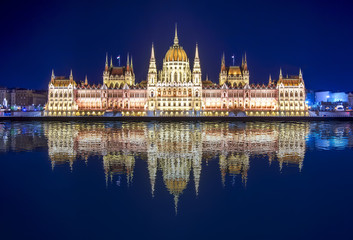 Hungarian Parliament at night with reflection in Danube river, Budapest, Hungary