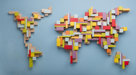 World map made from colorful wooden toy blocks.