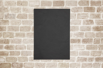 Blank black poster paper glued to the wall mockup