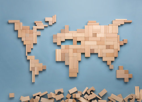 World map made from wooden toy blocks.