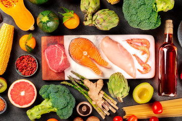 Food variety, a flat lay composition with meat, fish, chicken and shrimps, vegetables and fruits,...