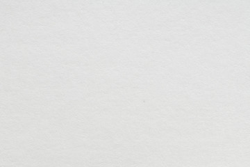 White blank piece of paper. A high resolution photo of paper ideal as a background or texture.