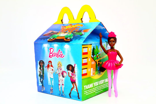 Los Angeles, California – December 2, 2019: McDonald's Happy Meal cardboard box with printed Mattel BARBIE and Hot Wheels Toys. McDonald's is a fast food restaurant chain