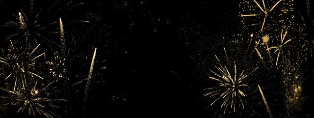 Goldenes Feuerwerk auf schwarzem Hintergrund-abstrakter Hintergrund, Banner für Silvester und...