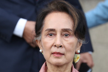 Myanmar's leader Aung San Suu Kyi leaves after a hearing at International Court of Justice in The Hague