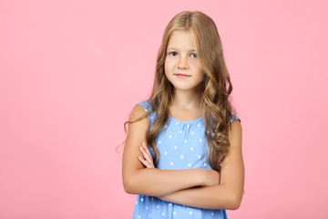 Pretty little girl on pink background