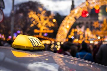 Taxi car at street near Christmas market in Vienna