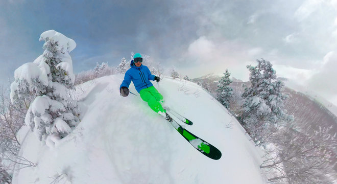SELFIE: Man on active winter vacation goes skiing in the untouched backcountry.