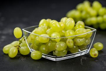 Fresh made White Grapes on a slate slab (close-up shot; selective focus)