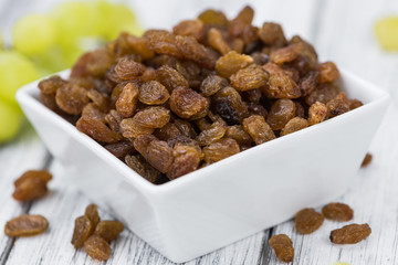Portion of healthy Raisins (selective focus; close-up shot)