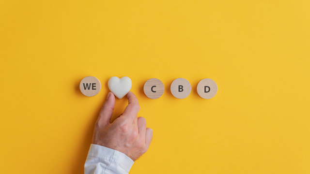 Male hand making a We love CBD sign