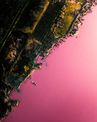 Aerial above a pink lake in Spain