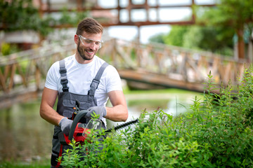 Photo sur cadre textile Pistache Handsome man dressed in gardening outfit