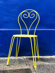 Yellow Chair With Blue Background
