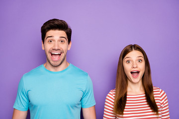 Closeup photo of two funny people couple positive emotions good mood open mouth listen unbelievable news wear stylish casual outfit clothes isolated purple color background