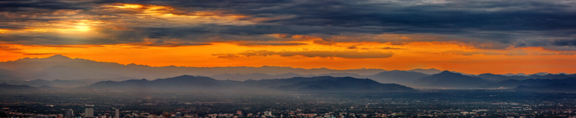Foto auf Acrylglas Cappuccino panoramic Majestic sunset sky over the mountains landscape