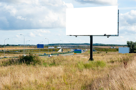 Blank white billboard for advertisement near the highway