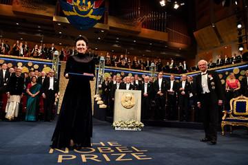 Polish author Olga Tokarczuk receives the 2018 Nobel Prize from Sweden's King Carl Gustaf during the Nobel Prize award ceremony at the Stockholm Concert Hall in Stockholm