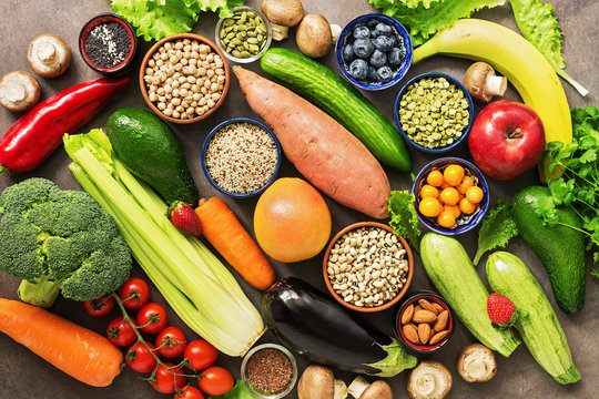 Healthy food for a vegetarian and vegan dishes. Foods high in antioxidants and vitamins. Nutrition, diet, clean food concept. Vegetables, fruits, berries, seeds. Top view, flat lay.