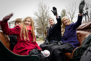 Kentucky's Democratic Governor Beshear greets supporters during his inaugural parade in Frankfort