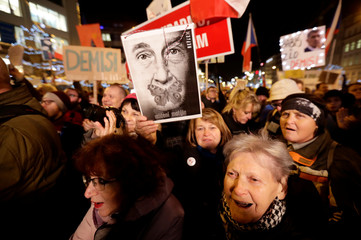 Demonstrators march during a protest rally in Prague