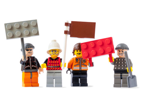 Workers on strike concept with four Lego toy figurines isolated on white background on 12 July, 2015 in Vilnius, Lithuania